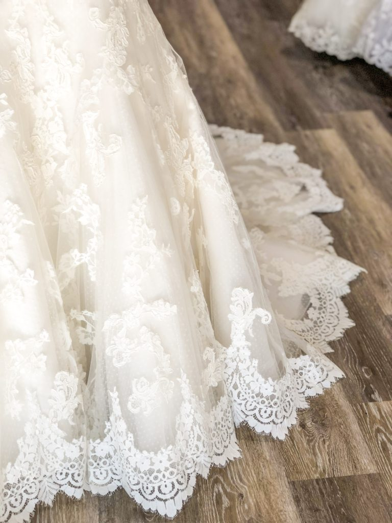 scalloped lace hem on discount designer wedding dress in Hayward, CA