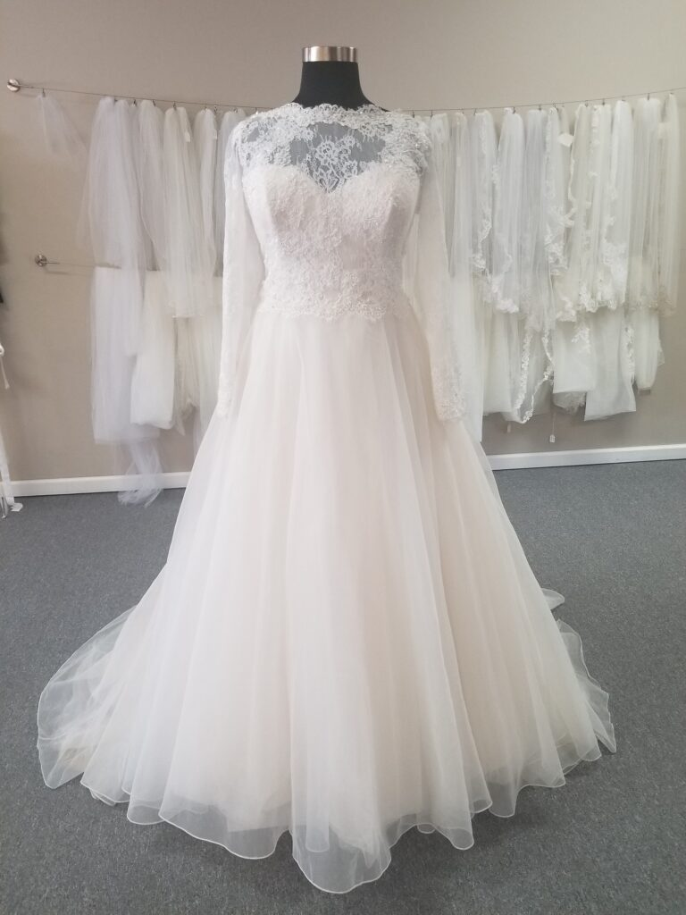 long sleeve plus size ballgown wedding dress with lace bodice and organza skirt