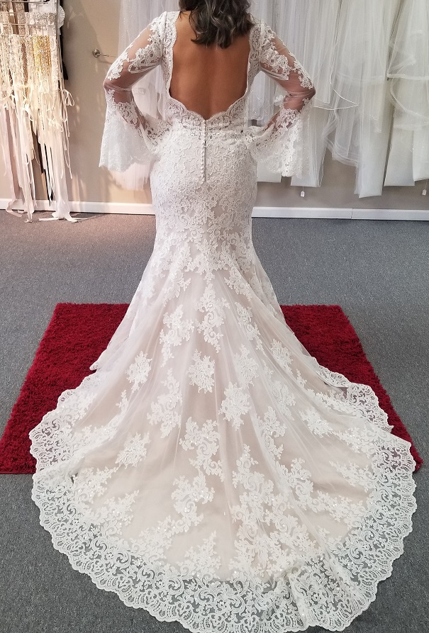 low cut back of boho lace mermaid wedding dress