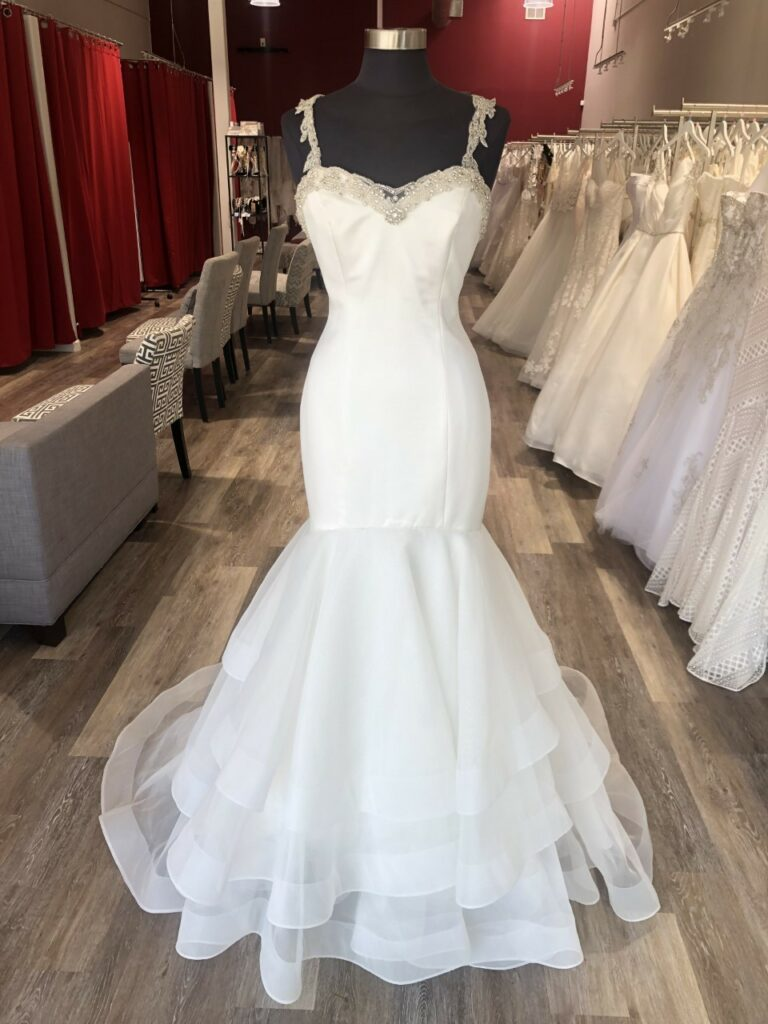 Wedding dress with added beaded neckline and straps.
