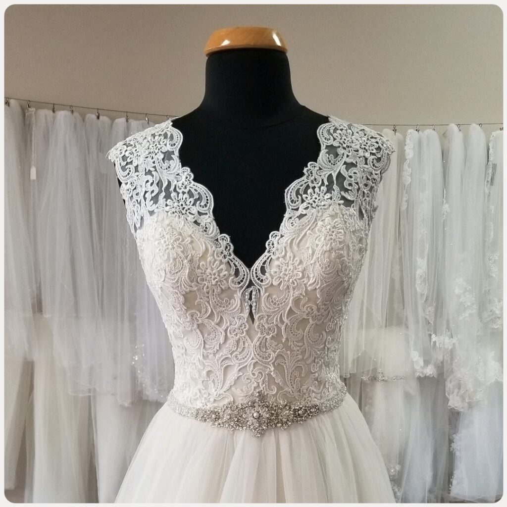 cap sleeve lace aline wedding dress with beaded belt