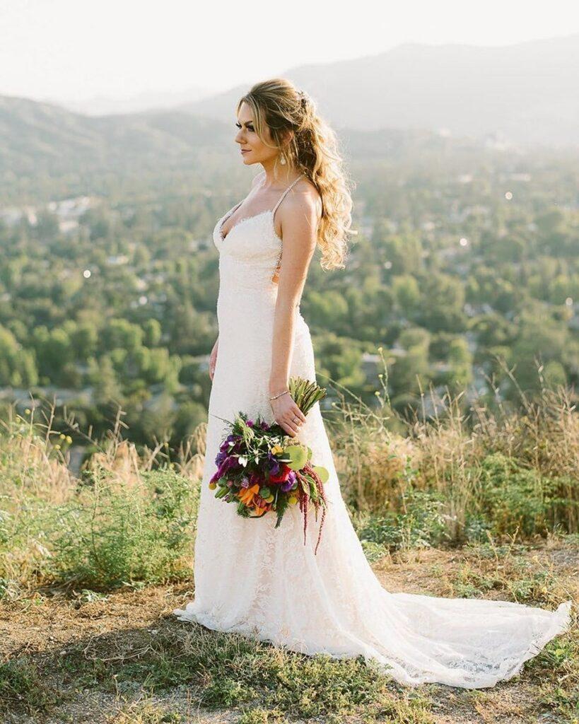 bride wearing a sheath wedding dress overlooking the suburbs