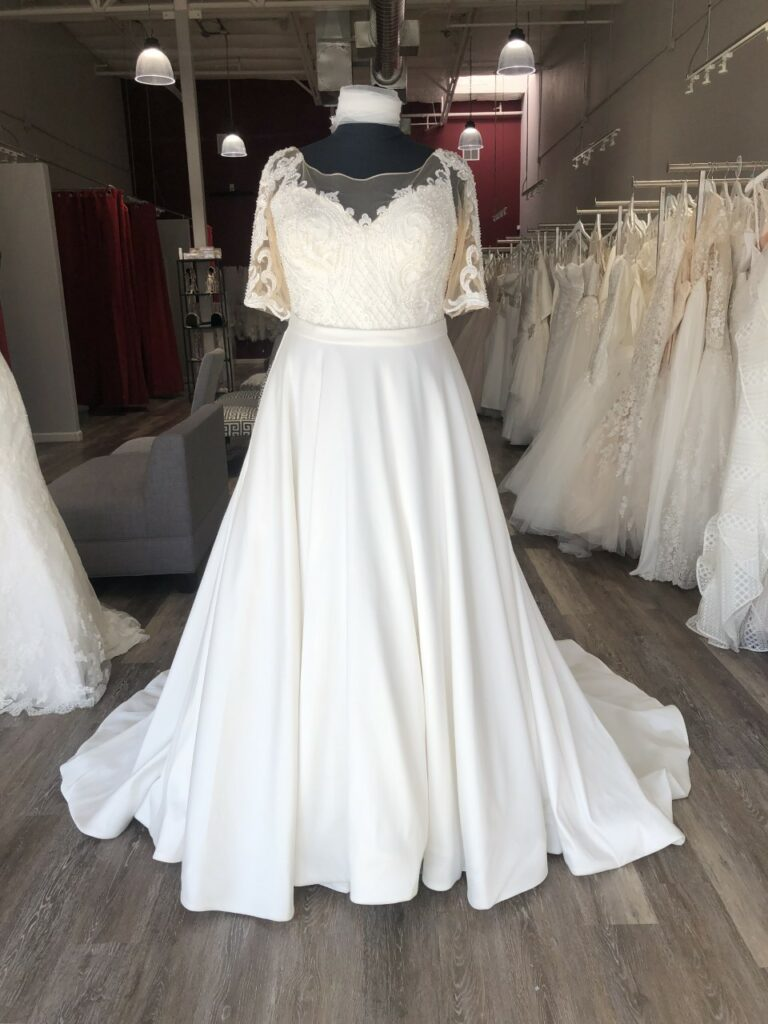 long sleeve beaded bodice satin skirt plus size wedding dress East Bay bridal store