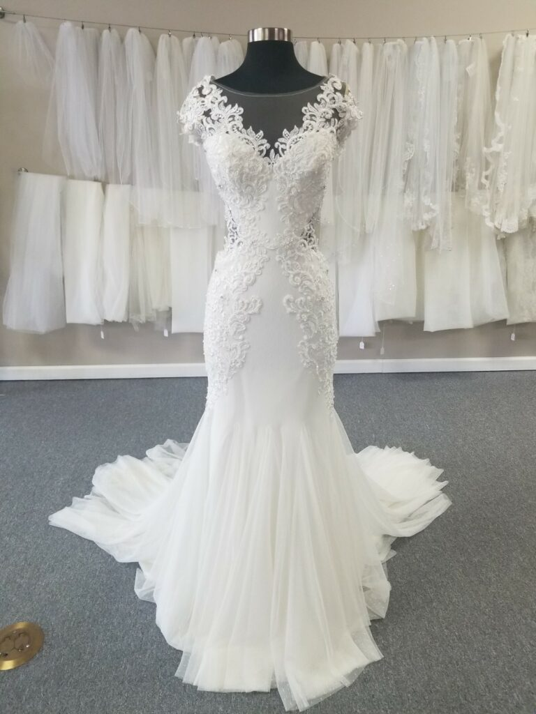 sexy trendy affordable wedding dress with illusion neck and side cutouts