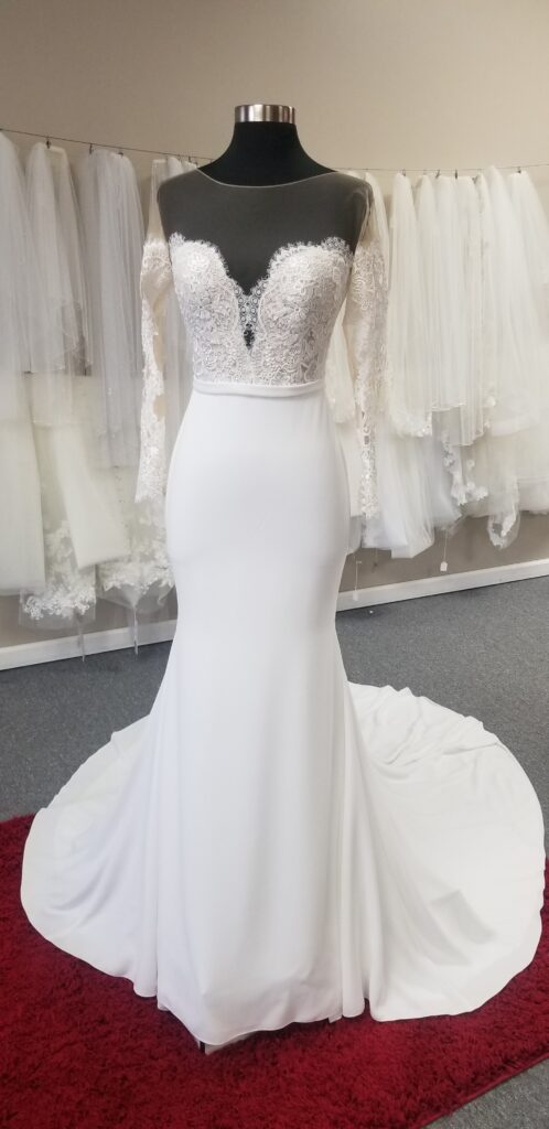 long-sleeve-off-the-shoulder-illusion-crepe-wedding-dress-from-pronoivas-at-whittier-california-bridal-store