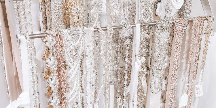 wedding belts and sashes on a rack in orange county area bridal boutique