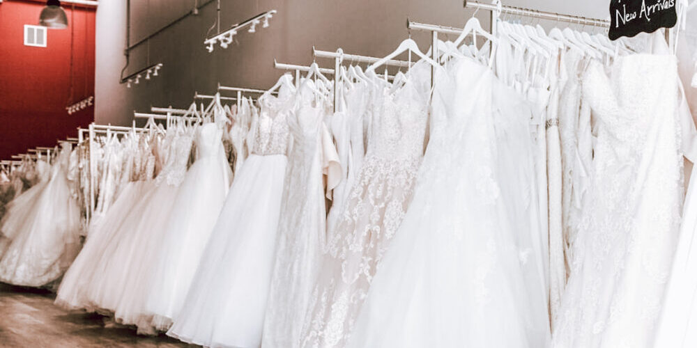 racks of new designer discount wedding dress sold off the rack in hayward california bridal store