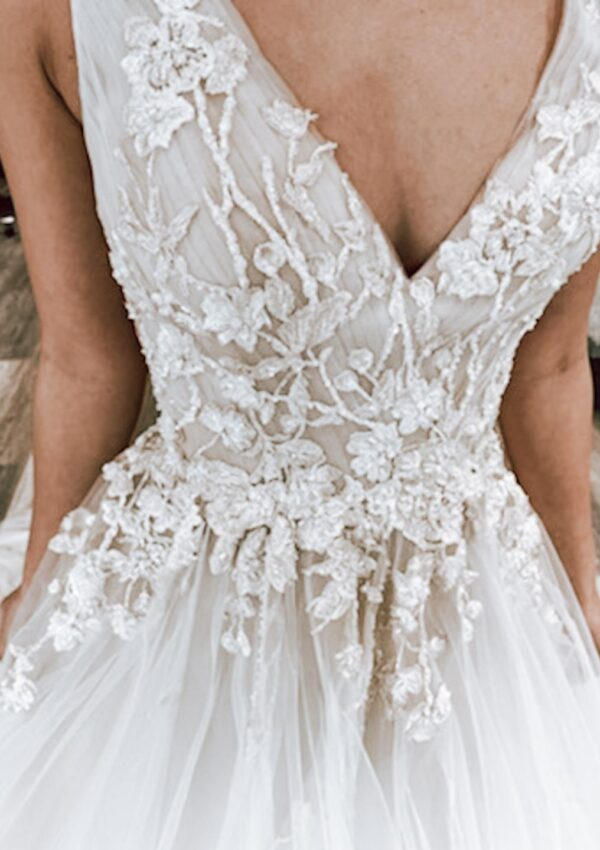 close up of vneck couture textured lace and tulle ballgown wedding dress